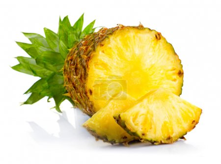 Photo for Fresh pineapple fruits with cut and green leaves isolated on white background - Royalty Free Image