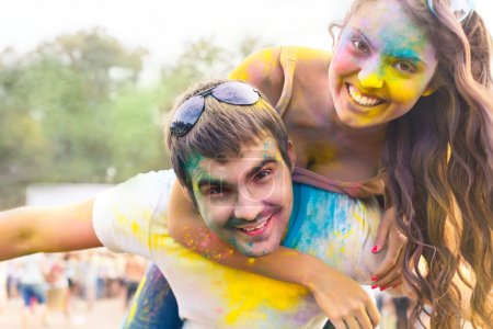Photo for Portrait of happy couple in love on holi color festival - Royalty Free Image