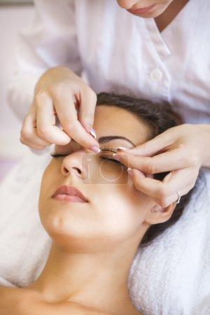 Beautiful young woman in cosmetic salon
