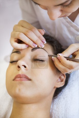 Portrait of a beautiful young woman in cosmetic salon