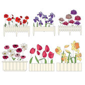 Flower pots with cultivated flowers Decorative fence