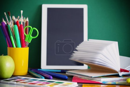 school stationary on wooden table