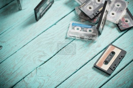 audio tapes on blue wooden background