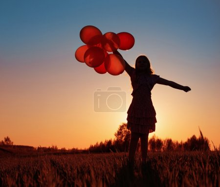 Photo for Girl with orange balloons outdoor - Royalty Free Image