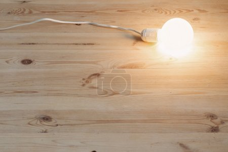 Light bulb lamp on wooden floor