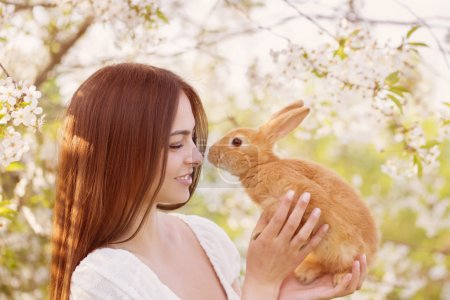 beautiful young women with rabbit