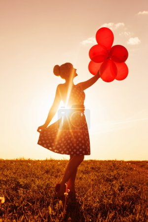 Photo for Beautiful women with balloons at sunset - Royalty Free Image