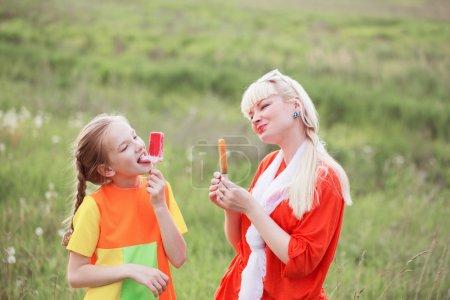 Happy family eating ice-cream outdoors