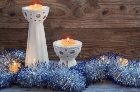 Christmas candle on wooden background