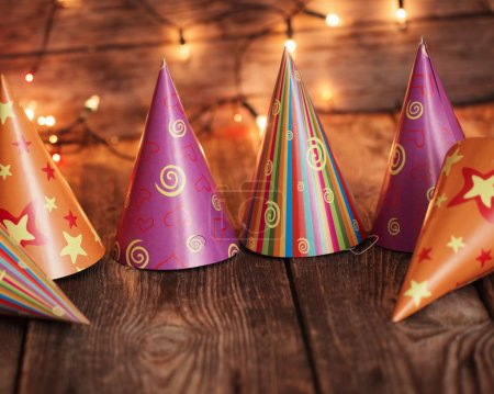 party hats on old wooden background