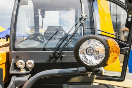 parking lamp on yellow tractor.