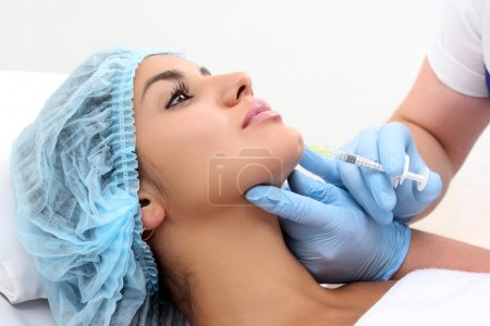 Photo for Beautiful girl on rejuvenation procedure in beauty clinic filler injection. - Royalty Free Image