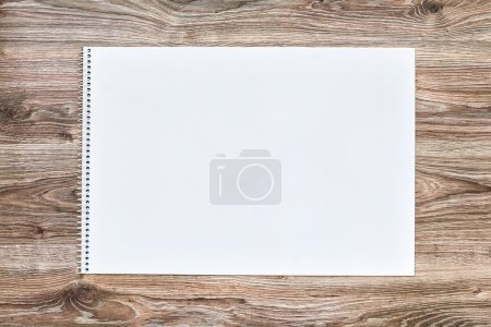 Photo for Mockup of open album with blank white page on wooden background. Gorizontal orientation, top view. - Royalty Free Image
