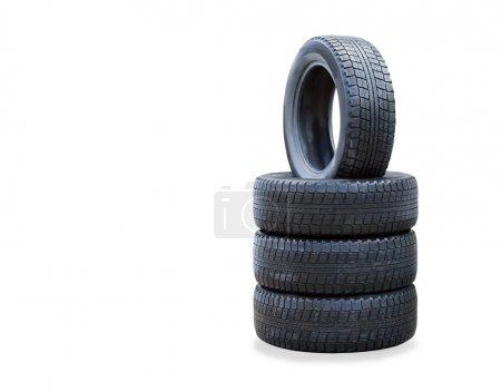 Photo for The stack of four winter new tires over white - Royalty Free Image