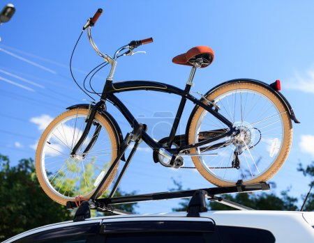 Bike transportation - bike on the roof of a car
