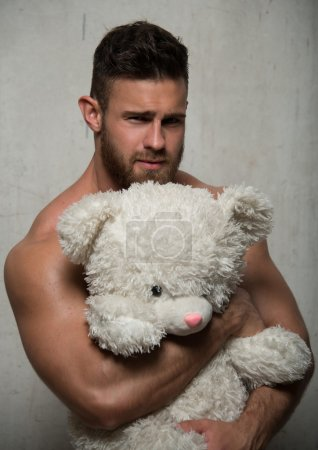 Model with teddy bear