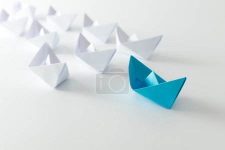 Photo for Leadership concept using blue paper ship among white - Royalty Free Image