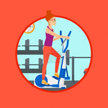 Woman exercising on elliptical trainer.