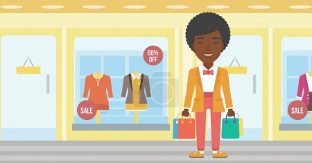 Illustration pour Femme afro-américaine tenant des sacs à provisions sur le fond de la vitrine avec des mannequins habillés. Joyeux jeune femme portant des sacs à provisions. Illustration vectorielle de design plat. Mise en page horizontale . - image libre de droit