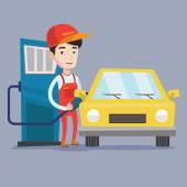 Worker filling up fuel into car