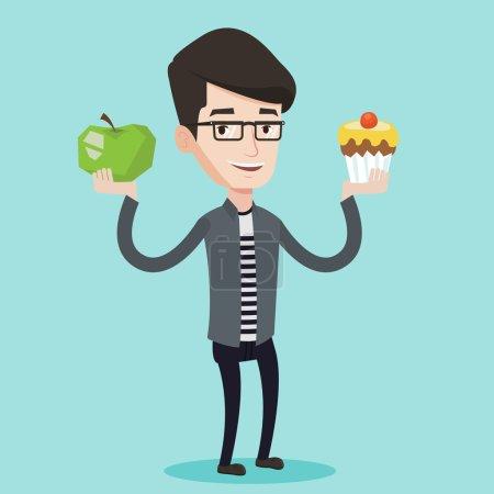 Man choosing between apple and cupcake.