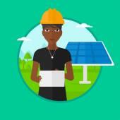 Female worker of solar power plant