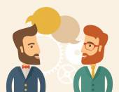 Two happy hipster Caucasian men with beard facing each other wearing jacket sharing and gathering ideas with bubble text on the top of their heads Team building concept A contemporary style with