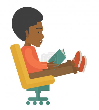 Black Man sitting with a book