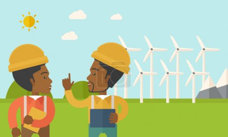 Two black workers talking infront of windmills.