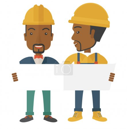 Two black architects wearing protection helmets looking at blueprint.