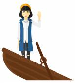 Business woman standing in sinking boat