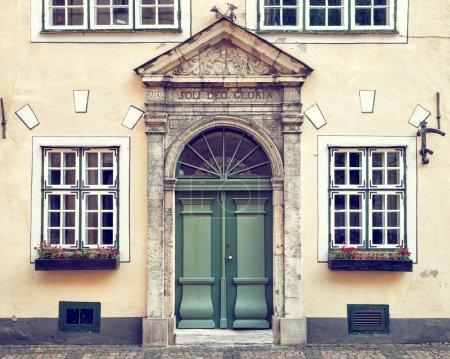 Vintage door on  a medieval building facade in old Riga, Latvia