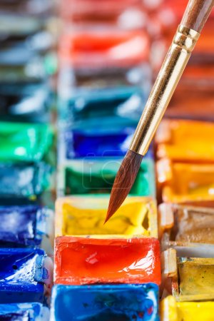 Photo for Brush for painting close up and set of watercolor paints. Selective focus. - Royalty Free Image
