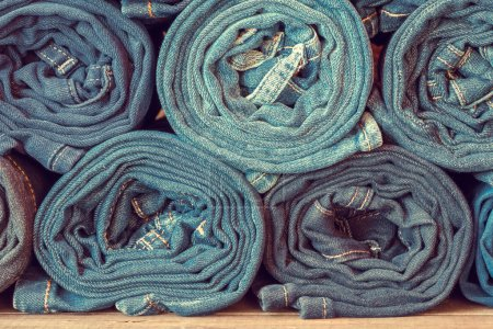 Rolled jeans background.