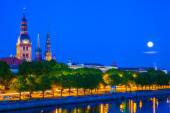 Old Town of Riga with reflection in Daugava River at night. Latvia