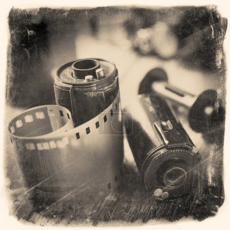 Old photo film rolls, cassette and retro camera. Vintage photo s