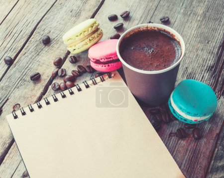Photo for Macaroons cookies, espresso coffee cup and sketch book on wooden rustic table, vintage stylized photo - Royalty Free Image