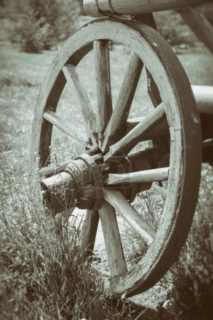 Photo for Vintage stylized photo of wooden cart wheel - Royalty Free Image
