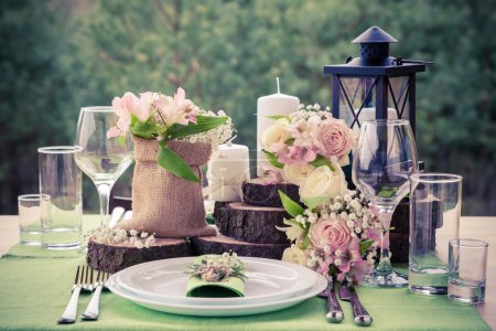 Wedding table setting in rustic style.