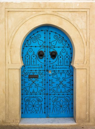 Blue aged door with ornament