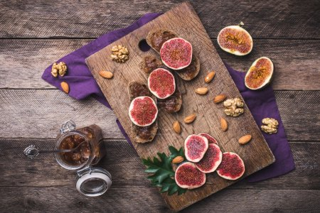 Sliced figs on bread with jam