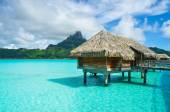 Thatched roof honeymoon bungalow on Bora Bora