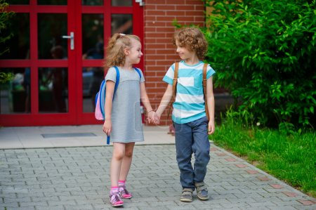 Two first graders on a schoolyard.