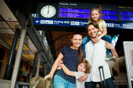 Young couple with two cute kids at the station.