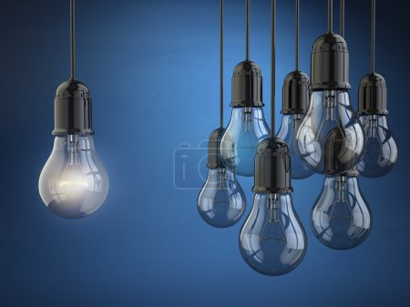 Idea or leadership concept. Group of light bulbs on the blue bac