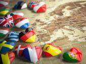 """Постер, картина, фотообои """"Карта Европы и сердца с флагами стран Европы. Траве"""""""