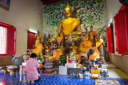 Buddhist worshiper praying in Buddhist temple