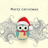 Creative floral design decorated greeting card with cute owl in Santa cap for Merry Christmas celebration