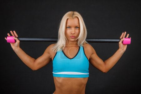 Blond fitness woman doing exercises