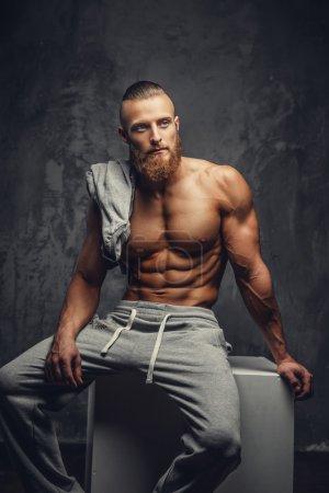 Shirtless muscular man with beard